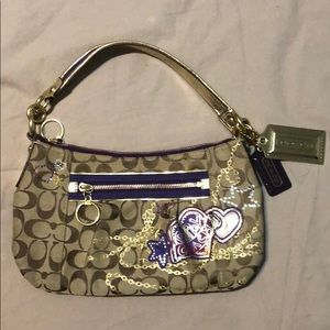 NWOT Poppy edition Coach purse in purple and gold